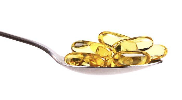 spoon full of fish oil capsules